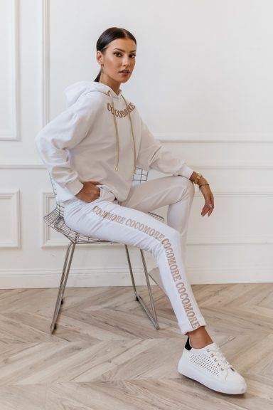 Cocomore białe spodnie z beżowym lampasem 40 L